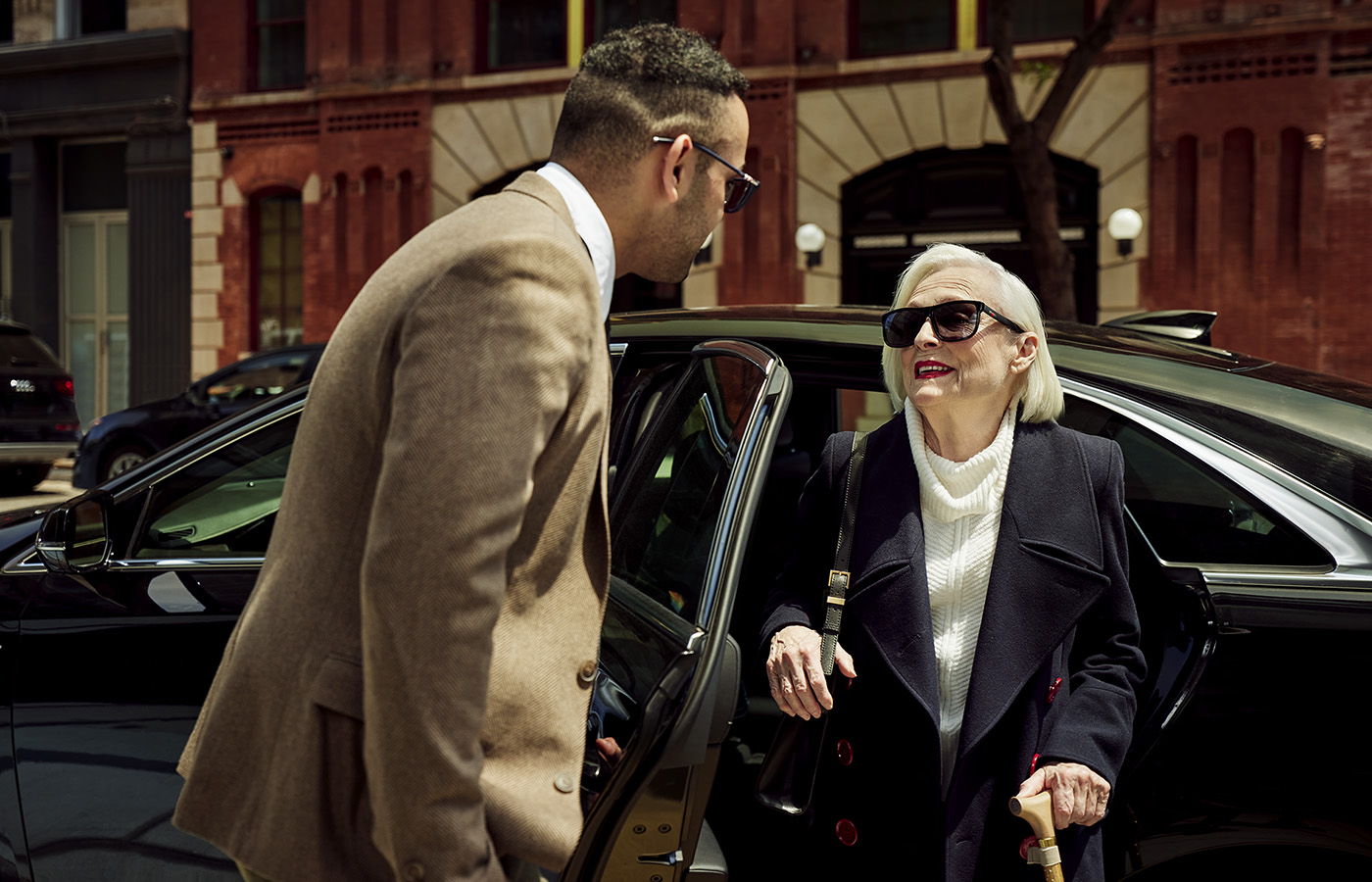 Woman arriving at her luxury Coterie Senior Living residence.