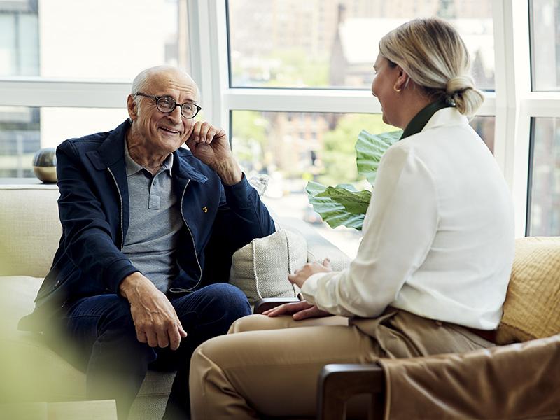 A Coterie Senior Living resident enjoying a conversation with an employee